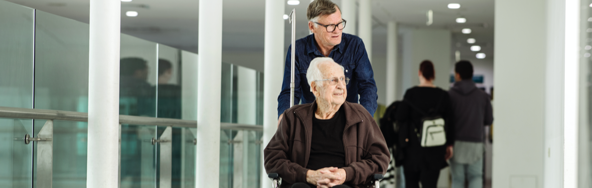 Patient in a wheelchair and his carer at Austin Hospital
