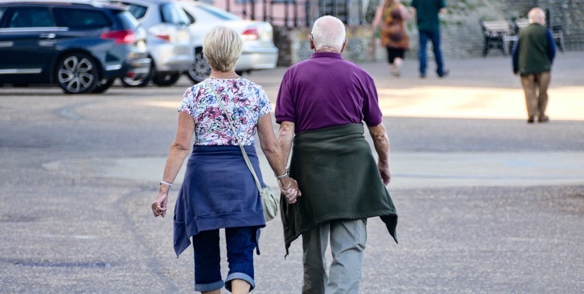 Older couple walking down the street